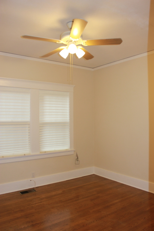 Fabulous Find: MIRACLE MILE Beautiful Duplex Surrounded by Windows, Fireplace